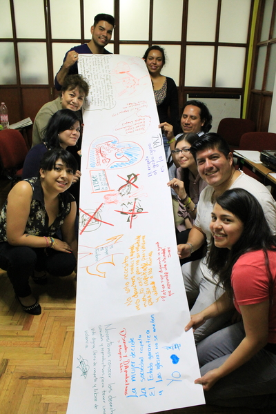 Young activists participating in the 'Hablemos en voz alta' workshop in Mexico showcase their Graffiti wall exercise to creatively express the importance of sexual and reproductive rights in their lives. ©Amnesty International