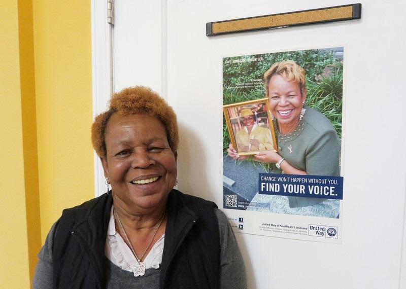 Elizabeth, gun and domestic violence survivor. Her daughter, in the poster behind her, was killed by Elizabeth's ex-partner