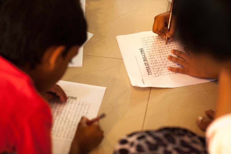 Young people attending the session on bullying play games and solve puzzles to understand the concept of bullying, Lightroom Bookstore, Bangalore, India, 30 May 2015 © Amnesty International India