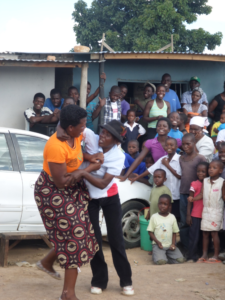"""The """"All Generations Drama Group"""" performing a scene on gender based violence. March 2014, Harare Hopley Farm Settlement Zimbabwe. © Amnesty International"""