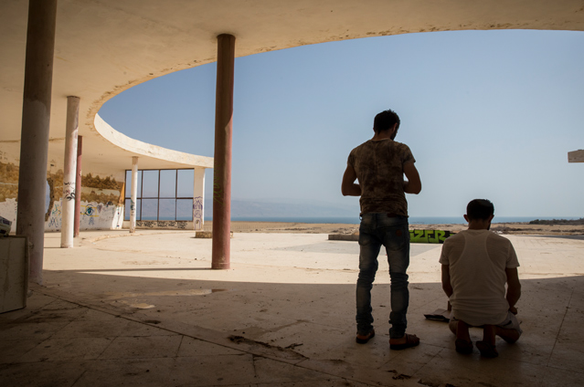 Palestinian tourists from Nablus pray in an abandoned lido near the Dead Sea in the Jordan Valley. Since 1967, the Israeli authorities have denied Palestinians access to the Jordan River has been restricted entirely along its whole course through the West bank. Water levels in the Dead Sea have fallen dramatically over the past 50 years due to diversion of the river Jordan up stream by Israel as well as Jordan and Syria. The Dead Sea now lies around half a kilometre away from the lido when once it surrounded it. © Amnesty International