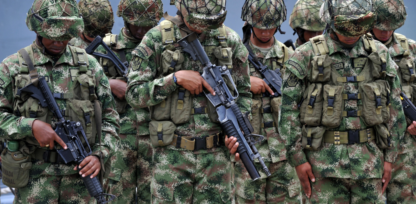 Soldiers in Colombia bowing their heads