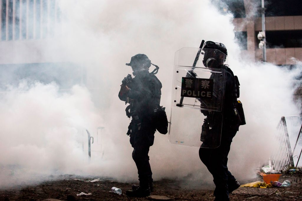 Riot police in Hong Kong respond to protests against changes to extradition law with tear gas. 12 June 2019.
