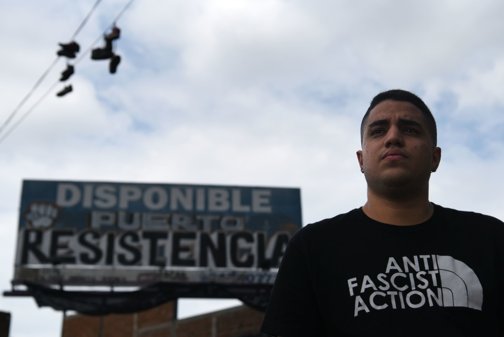 Carlos Peña is 24 years old and has been a political activist for 5 years. He says that the triumph of this protest is that people understood that democracy is also made in the street. Photo: Christian Escobar Mora/Amnesty International