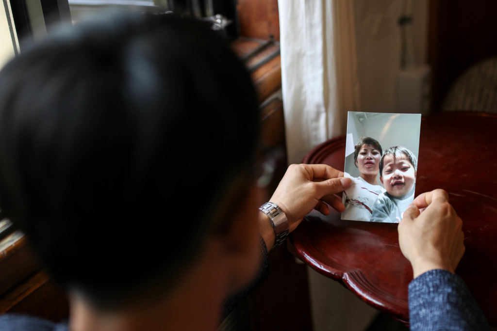 Lee Tae-won with a picture of his wife and son who were sent back to North Korea from China.