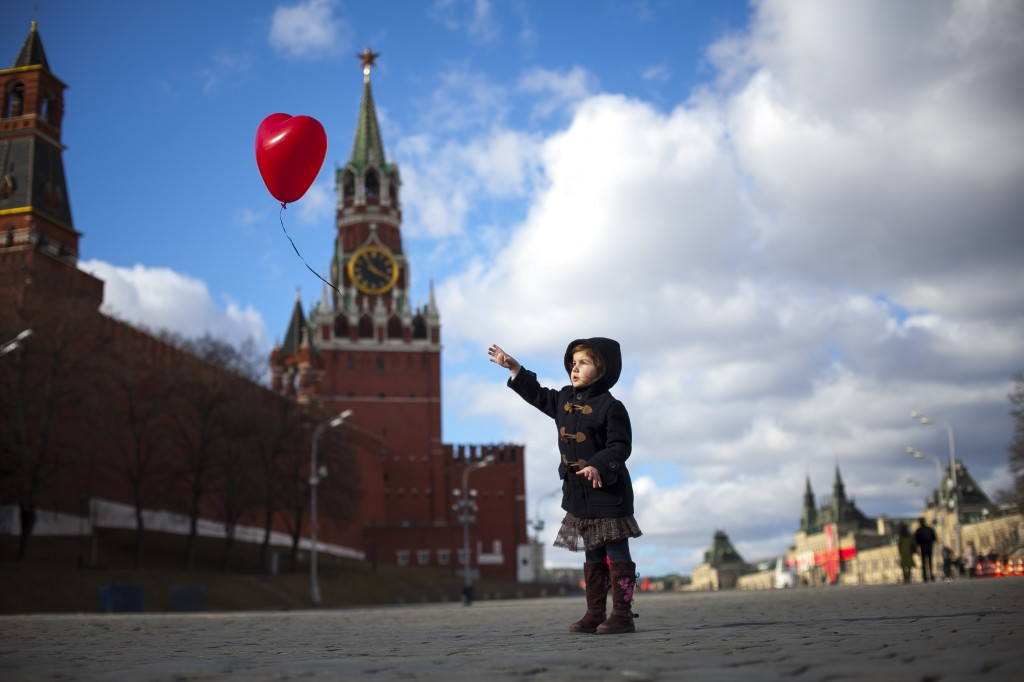 'The girl with the red balloon'. Moscow, March 2014. © Ivan Proskuryakov